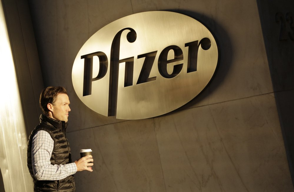 A man enters Pfizer's world headquarters in New York.