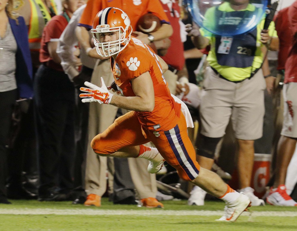 Clemson wide receiver Hunter Renfrow runs for a touchdown in the second half, putting his team on the way to a win in the Orange Bowl and a spot in the national championship game.