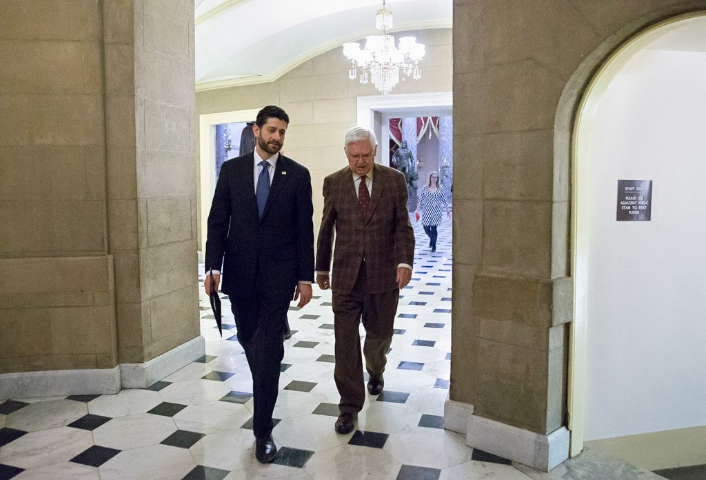 Speaker of the House Paul Ryan, left, and Appropriations Committee Chairman Hal Rogers return to Ryan's office after passing the omnibus bill, at the Capitol in Washington, Friday. The House easily passed a $1.14 trillion spending bill to fund the government through next September, capping a peaceful end to a yearlong struggle over the budget, taxes, and Republican demands of President Barack Obama.
