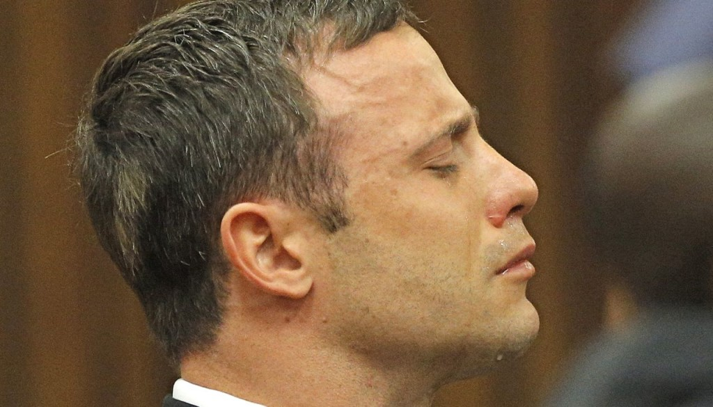 """Oscar Pistorius reacts as Judge Thokozile Masipa rules out a murder conviction in this Sept. 11, 2014, photo. On Thursday, Justice Lorimer Eric Leach of the Supreme Court of Appeal delivered a ruling  that Pistorius """"ought to have been found guilty of murder on the basis that he had fired the fatal shots with criminal intent."""""""
