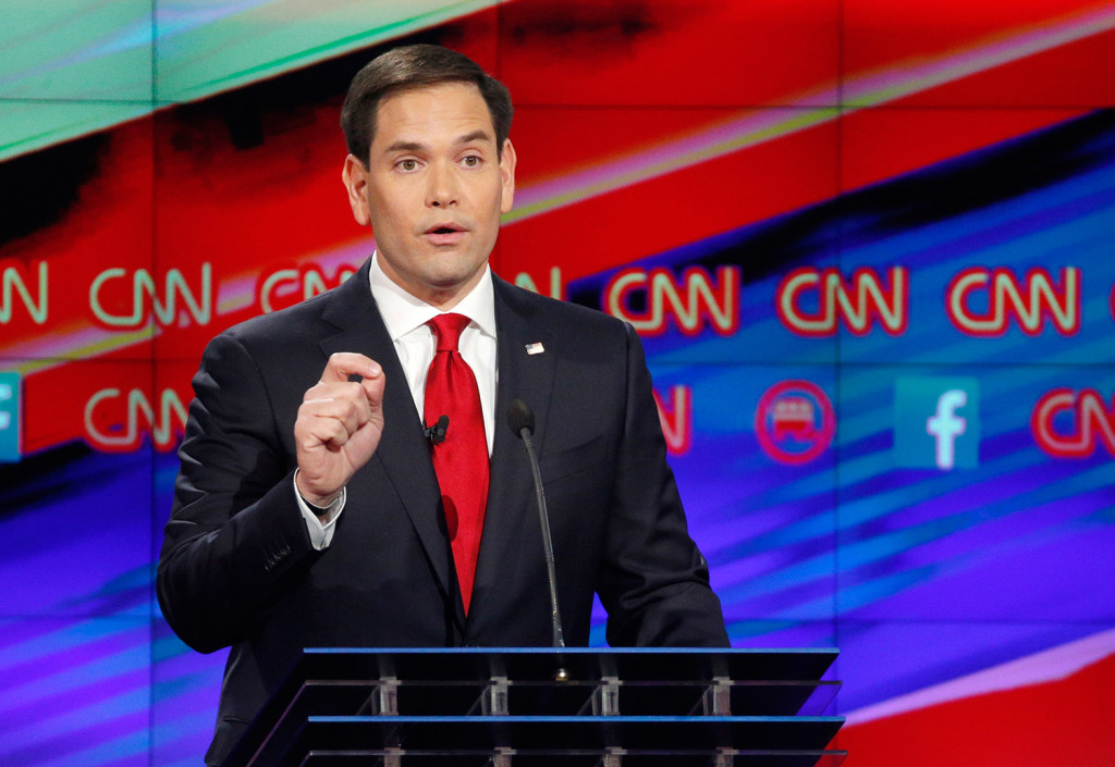 """Sen. Marco Rubio, speaking in the Republican presidential debate, said Donald Trump's plan to keep foreign Muslims out of the U.S. """"isn't going to happen."""" The Associated Press"""