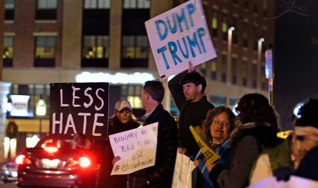 Protestors picket before Donald Trump's address to a regional police union in Portsmouth, N.H., on Thursday night. The Associated Press