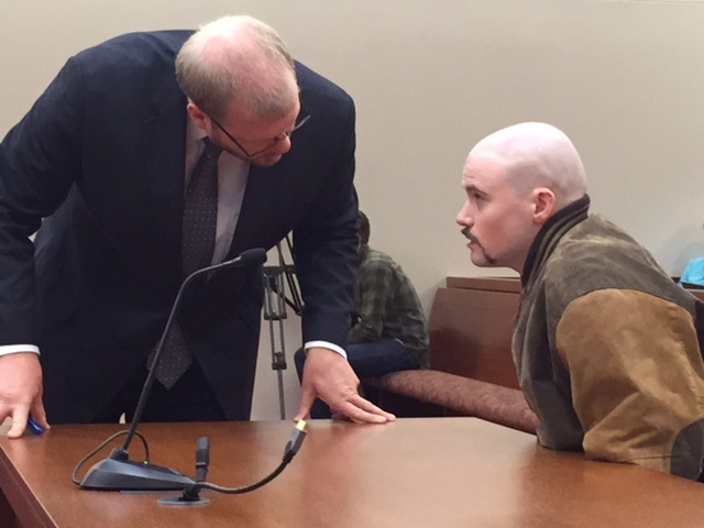 Attorney Scott Hess talks with his client Leroy Smith III Wednesday during a hearing in which the state wants permission to involuntarily medicate Smith so he can be made competent to stand trial in the death of his father.