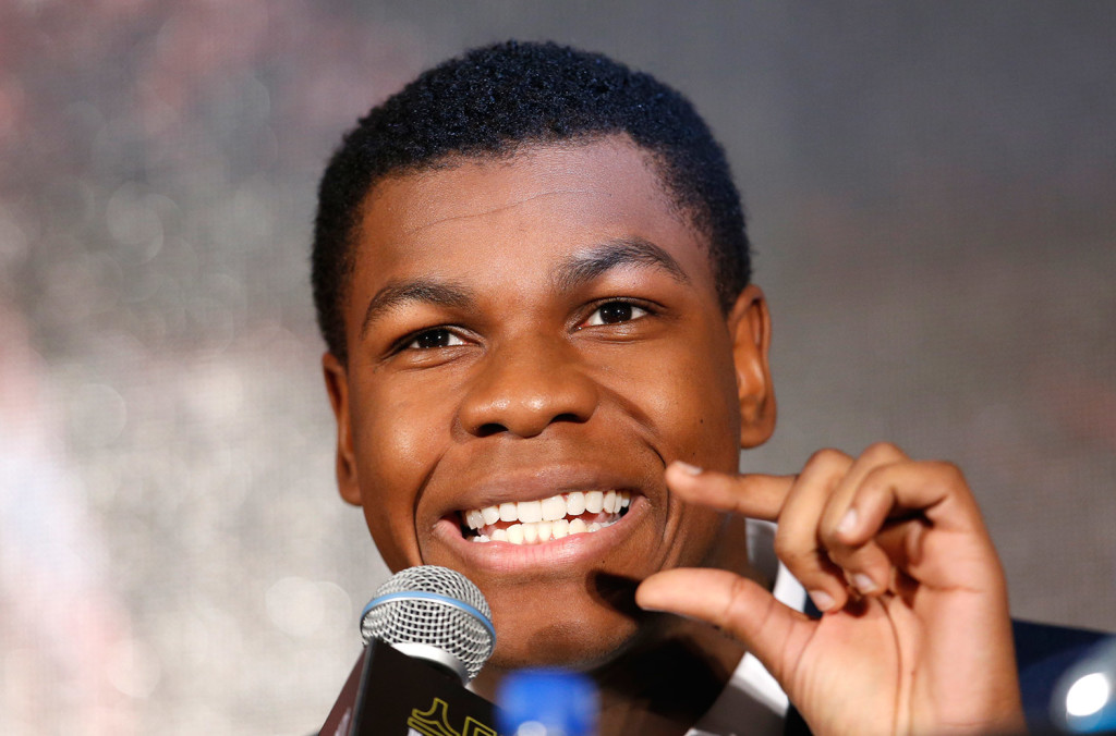 """Actor John Boyega answers a reporter's question during a press conference for """"Star Wars: The Force Awakens,"""" in Seoul, South Korea. The movie is to be released in South Korea on Dec. 17."""