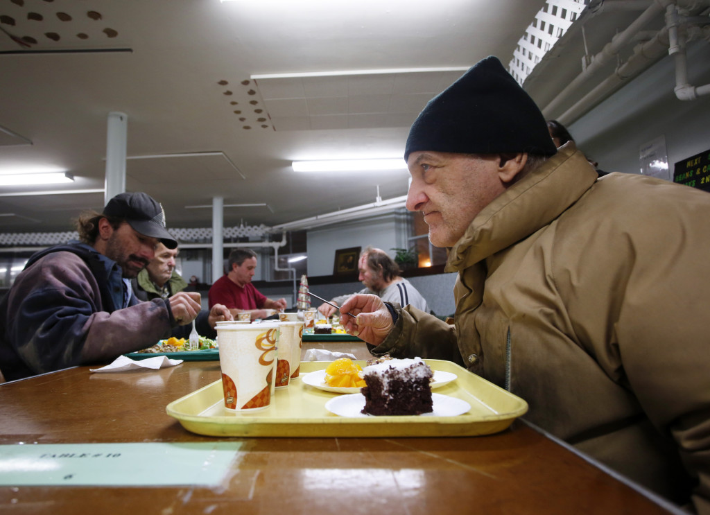 "Roland Hamel, 71, of Lewiston gets ready to tuck into his Calvary City Mission meal at Calvary United Methodist Church on  Jan. 6. ""They call me the buffet man,"" said Hamel, who likes to get a little bit of everything at the dinners,. Derek Davis/Staff Photographer"