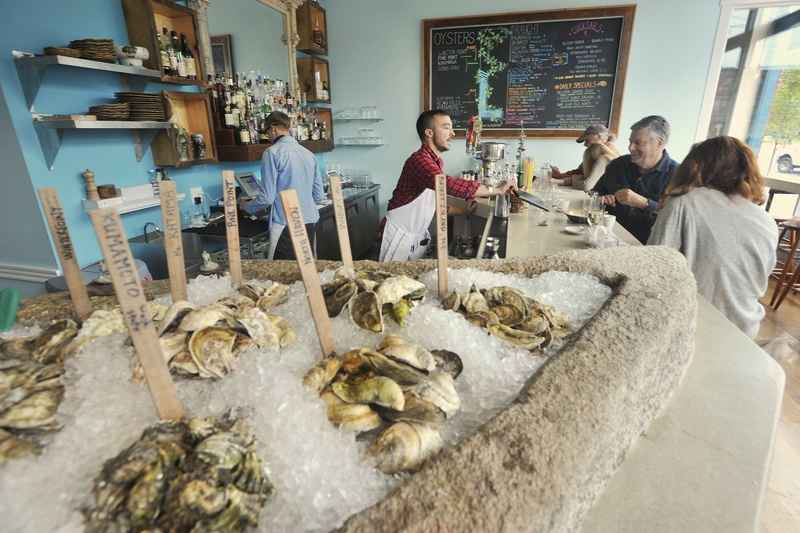 "Eventide Oyster Co. at 86 Middle St. in Portland ""combines foods from Maine and 'from away' in dazzling mash-ups."""