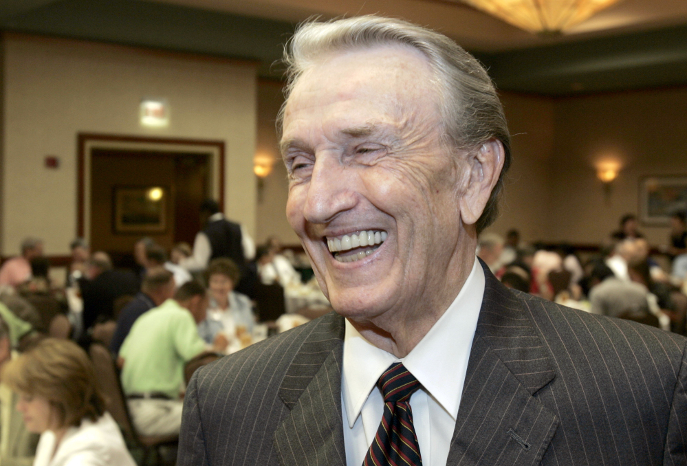 """In this 2006 photo, former U.S. Sen. Dale Bumpers, D-Ark., laughs after an interview before addressing an Energy and Value-Added Products from Biomass workshop in Little Rock, Arkansas. Bumpers, a former Arkansas governor and U.S. senator who earned the nickname """"giant killer"""" for taking down incumbents, and who later gave a passionate speech defending Bill Clinton during the president's impeachment trial, died Friday in Little Rock at age 90."""