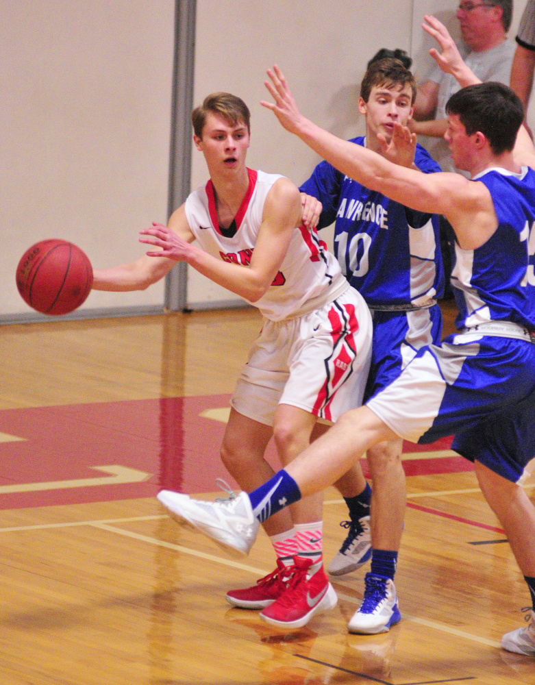 Cony's Carter Cleaves, left, looks for a teammate to pass to while Lawrence's Mason Cooper and Seth Powers defend him during a game Saturday at Cony High in Augusta.