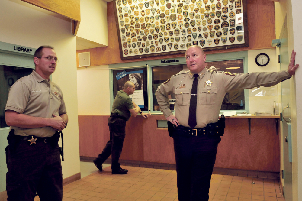 Franklin County Jail Administrator Major Douglas Blauvelt, left, and Sheriff Scott Nichols speak inside the entry lobby and control room to the jail in Farmington in October. Nichols said reopening the jail was a big success in 2015, and he looks forward to more in 2016.