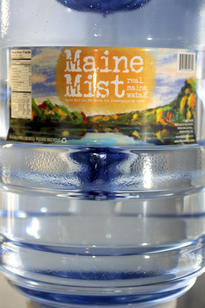 Ed and Deb Bowie are bottling and selling a line of water, Maine Mist, at their Farmingdale business, the Cobbossee Beverage Shop.