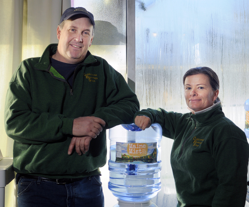 Ed and Deb Bowie, shown in a photo taken last week, are bottling and selling a line of water, Maine Mist, at their Farmingdale business, the Cobbossee Beverage Shop.