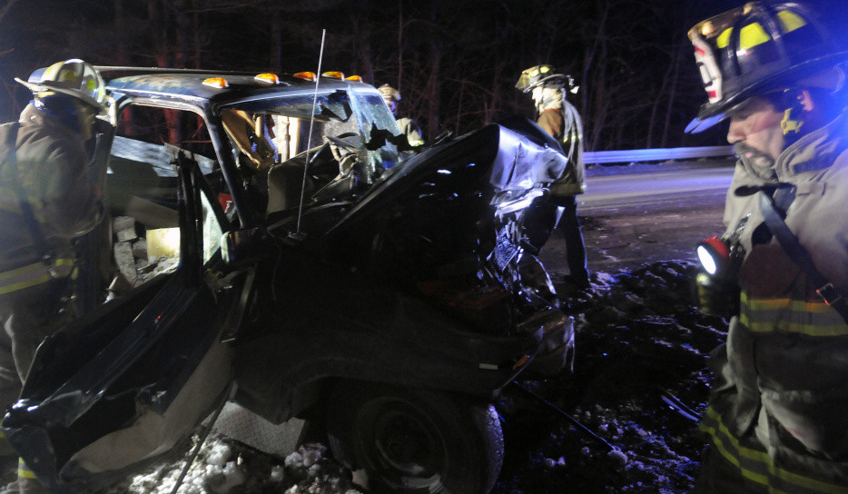 Firefighters check a pickup truck that collided with another pickup on Route 9 in Chelsea, injuring three people on Monday evening. All the victims had to be extricated from the vehicles, police said, to be treated for multiple, life threatening injuries.