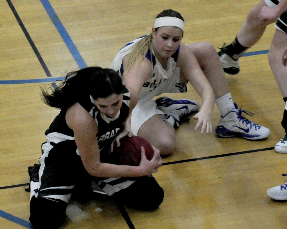 Carrabec's Kate Stevens, left, and Madison's Erin Whalen scramble hit the floor to compete for a loose ball during a Mountain Valley Conference game Monday night in Madison.