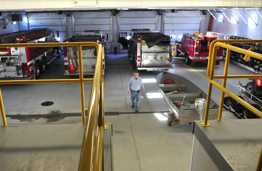 Norridgewock Fire Chief Dave Jones walks through the large equipment bay inside the new fire department building on Tuesday. The department moved from the old building after a 30-year money-raising campaign.