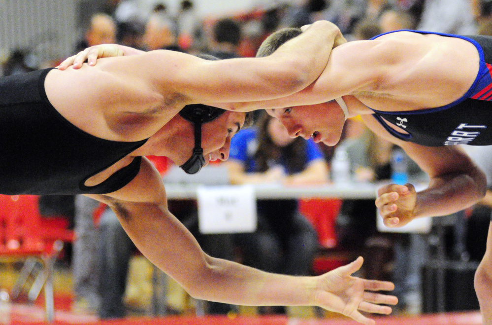 Staff file photo by Joe Phelan   Skowhegan's Kam Doucette, left, and Mt. Ararat's Robert Heatherman compete at the Cony Duals in Augusta earlier this season. Doucette is on a roll with the Indians of late.