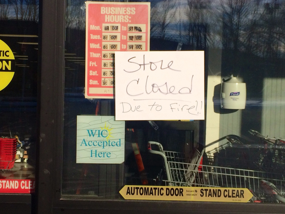 A sign on the front door of Jimmy's Market Wednesday advises customers that the store is closed because of a late-morning fire.