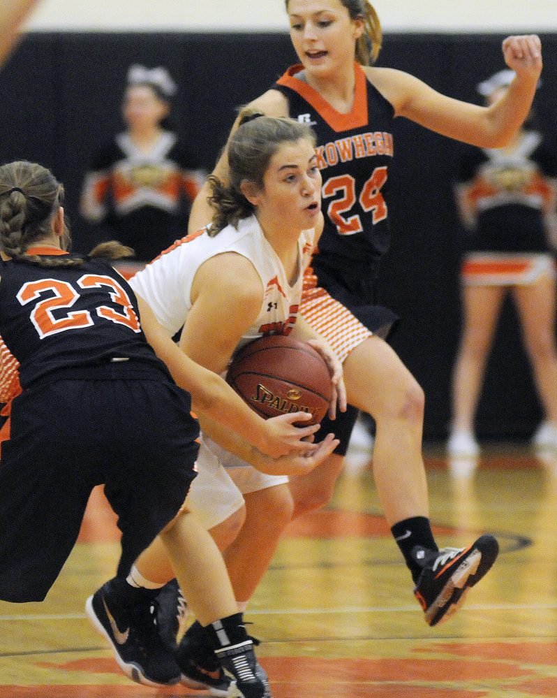 Gardiner's Lauren Chadwick, center, dribbles through Skowhegan's Alyssa Everett, left, and Tracey Swanson during a Class A North game Dec. 23. Swanson helps lead a young Indians team that has playoff aspirations.