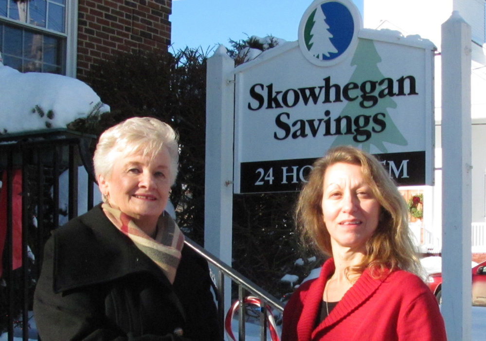 Contributed photo RFA President Millie Hoekstra, left, received a grant from Dawn Field, manager of Skowhegan Savings Bank's Rangeley Branch.