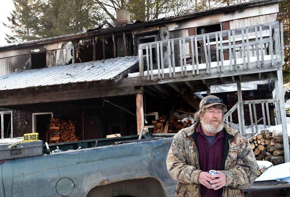 David Ladd stands in front of his Bunker Hill Road home that was destroyed by fire Thursday morning.