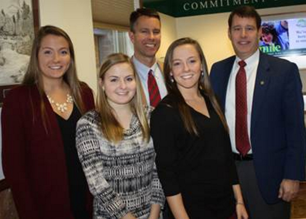 From left, are Hayley Quirion, Lindsey Quirion, Amos Byron, vice president and trust officer, Emily Quirion and Andrew Silsby, president and CEO of Kennebec Savings Bank.