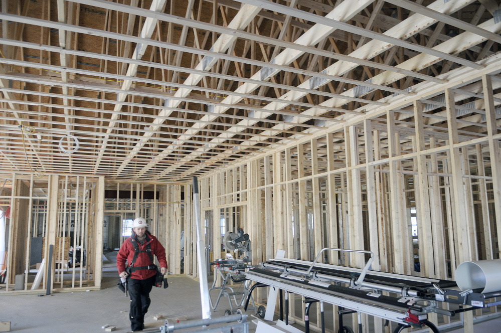 Uriah Pelletier of Kavestone LLC walks through the meeting room Wednesday at the future home of the Belgrade Town Office.