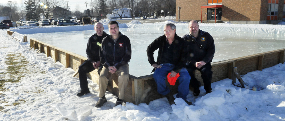 The outdoor public ice skating rink beside the Winslow Middle School is ready to open Saturday. From left are Winslow firefighter Tom Brown, Jim Bourgoin, director of Winslow Parks and Recreation, Ray Caron and firefighter Eric Rood.