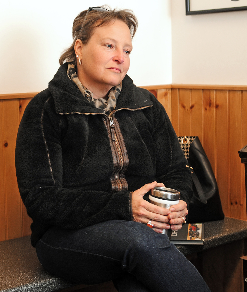 Susan Cloutier takes a break from answering questions Wednesday during an interview at United Fitness and Martial Arts in Winthrop.