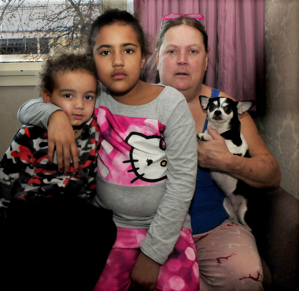 Jody Brunson holds her grandchildren, Booker, left, and Jocelin, and one of four pets saved from a Jan. 3-4 fire that destroyed the home they were living in at 144 Water St. in Waterville. The family, which also includes Brunson's daughter Marybeth, is moving back to South Carolina.