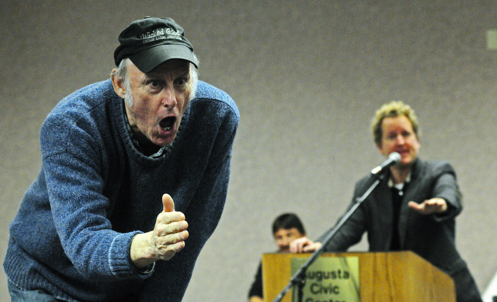 Rosey Gerry, left, encourages an audience member to make a bid Saturday while Ethan Yankura serves as auctioneer Saturday at the Augusta Civic Center. The event was a fundraiser for the Maine Vintage Race Car Association.