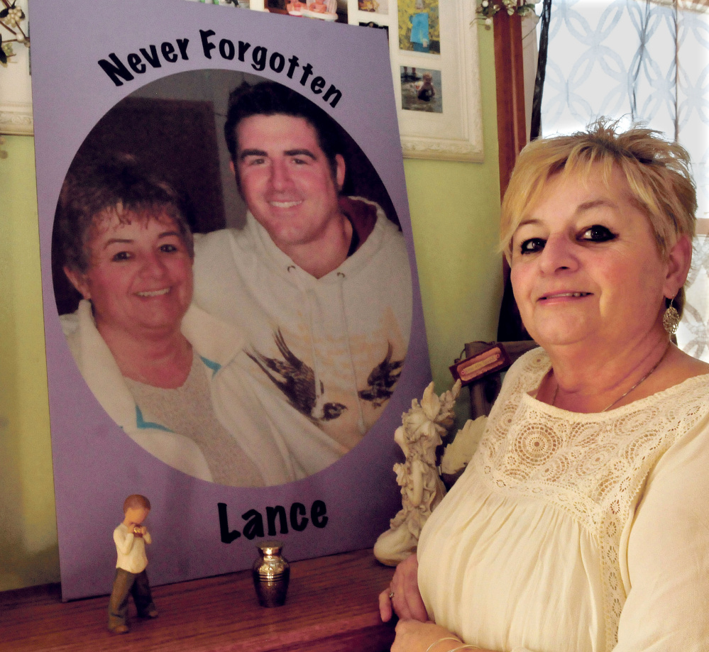 Ruth Perkins on Thursday stands beside a painting of herself and her son Lance made two years ago. Lance died of a drug overdose in April 2015.