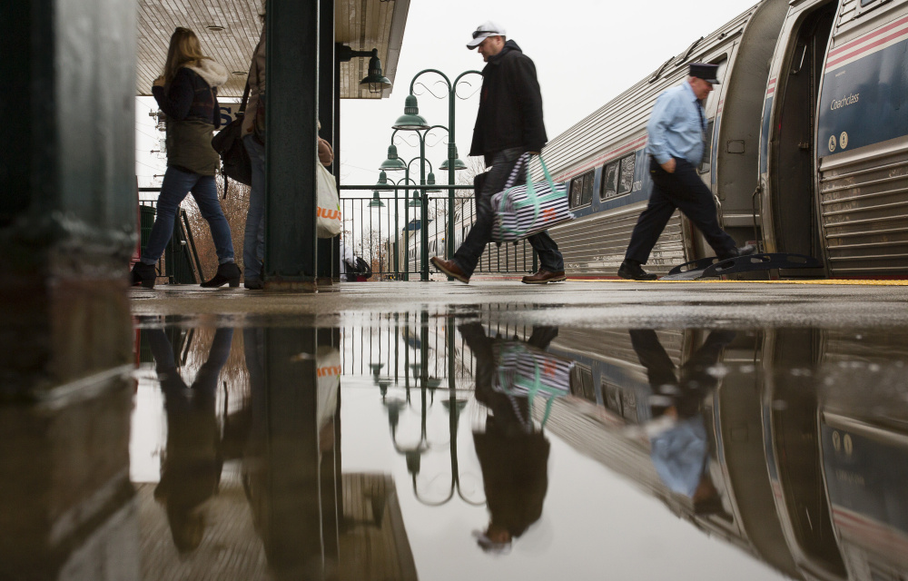 SACO, ME - JANUARY 10: Passengers disembark the northbound train from Boston at the Saco Transportation Center a rainy Sunday in Saco, Maine on January 10, 2016 . (Photo by Carl D. Walsh/Staff Photographer)