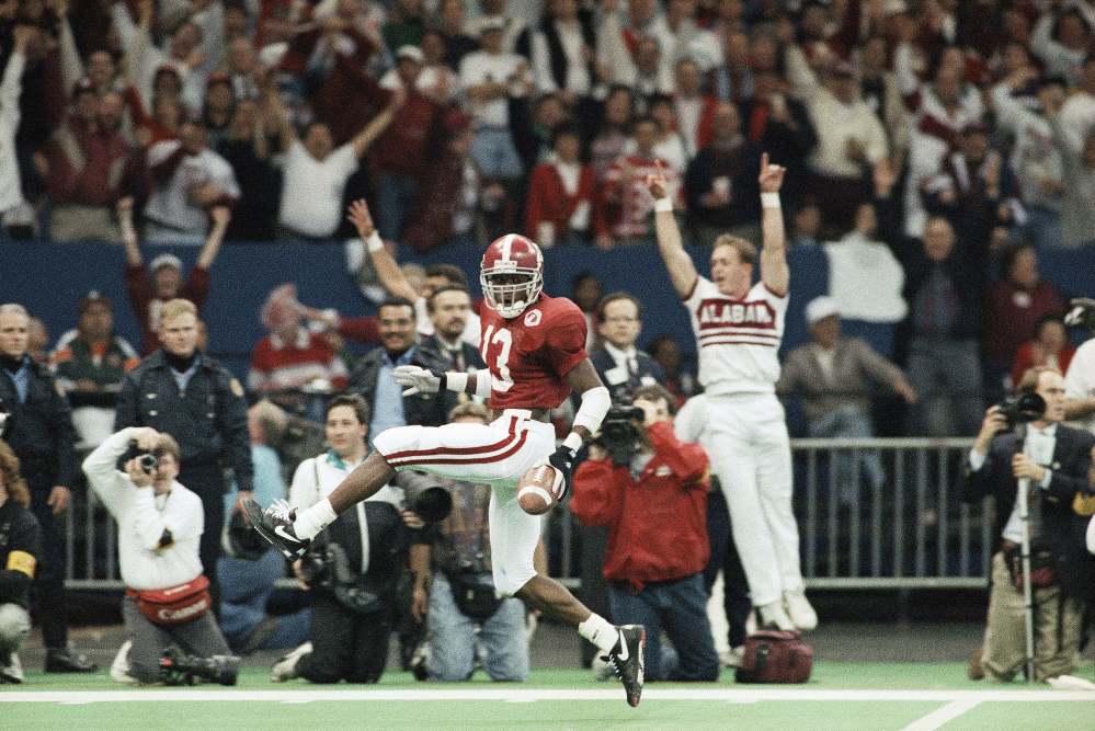 Alabama free safety George Teague dances his way into the end zone with a touchdown off an intercepted pass by Miami's Gino Torretta during the third quarter of the 1993 Sugar Bowl in New Orleans. The first title game chosen by the Bowl Coalition matched near-unanimous No. 1 Miami against Alabama. Both teams were undefeated, with Miami going for its second straight title and favored by eight points. But Alabama won its first national title since 1979, with a 34-13 win.