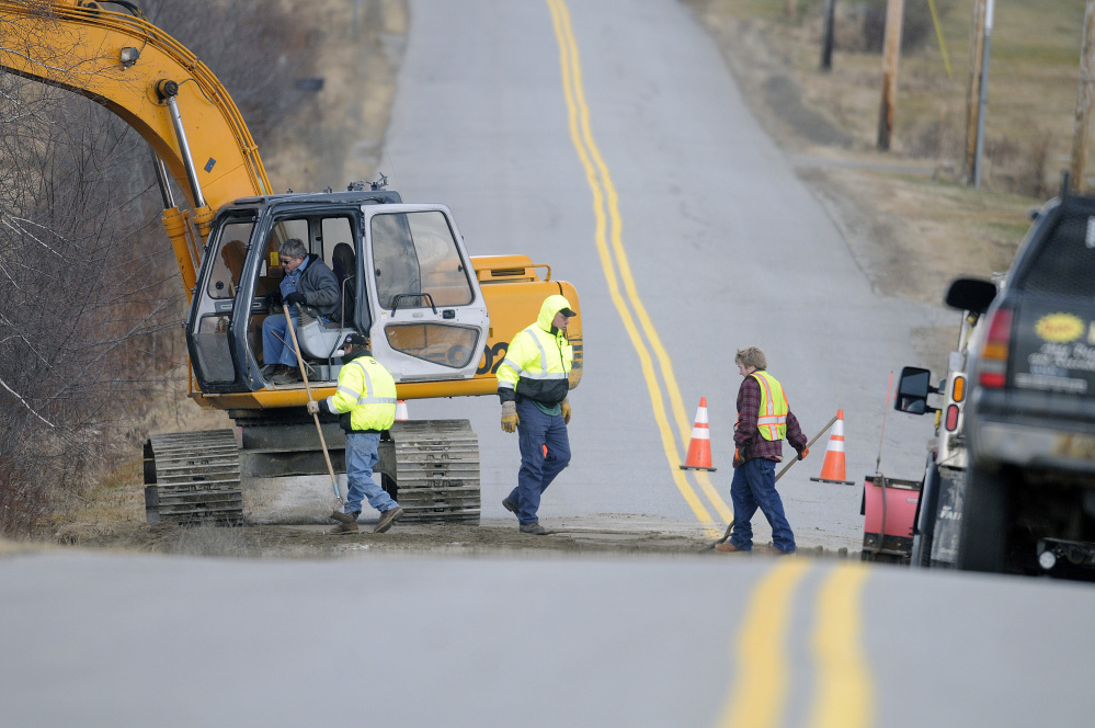 Crews repair South Monmouth Road in Monmouth on Monday after a culvert washed out during heavy rain on Sunday.