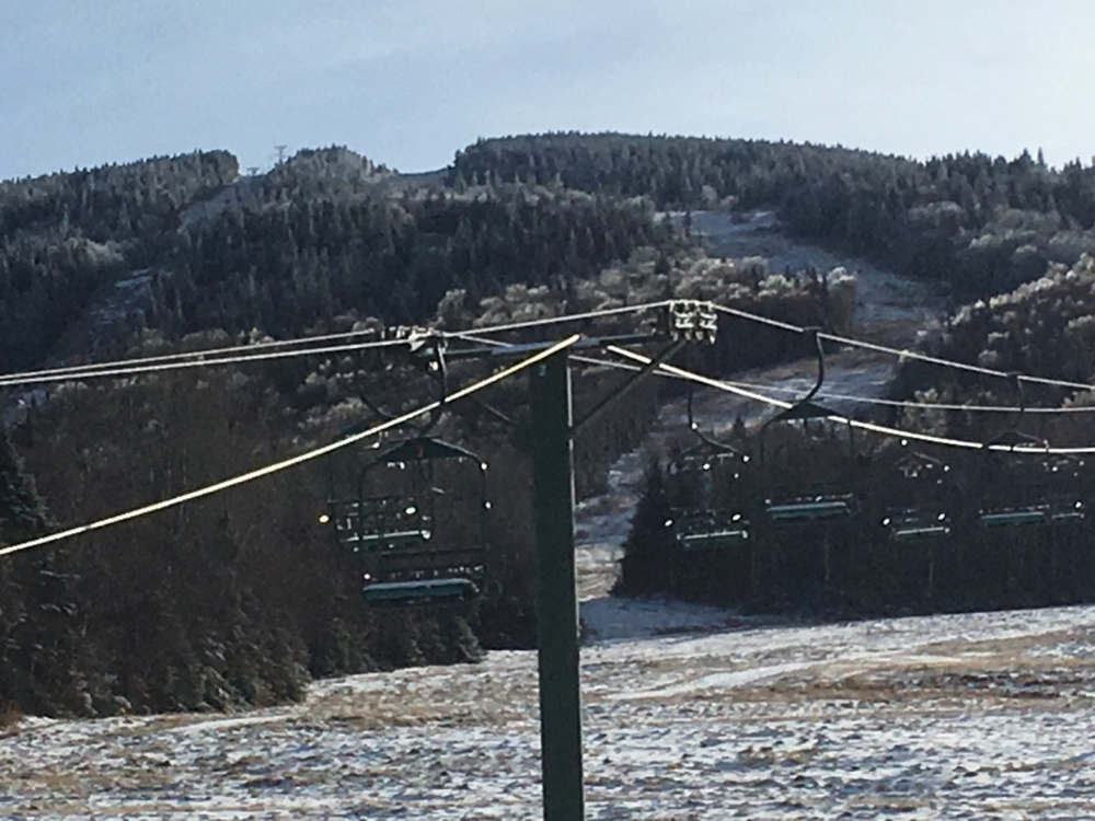 The chairlifts at Saddleback Mountain are empty and unused as the ski resort remains closed. The mountain may open later this month as the loose ends of a sale are tied up.