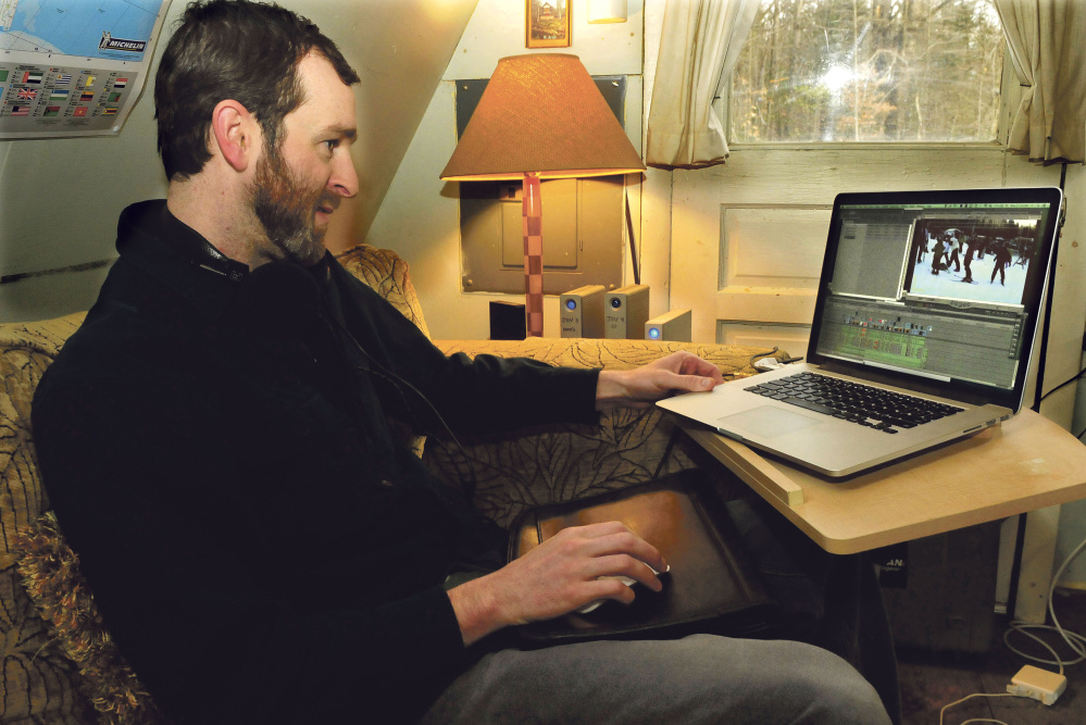 "Joel Osgood works from his home in New Portland Monday. His documentary on small Maine ski resorts, ""1,000 Feet & Below,"" premieres at The Rack at Sugarloaf Wednesday."