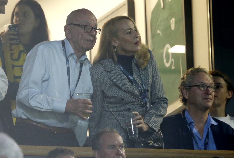 In this file photo, media mogul Rupert Murdoch stands with model Jerry Hall during the Rugby World Cup final between New Zealand and Australia at Twickenham Stadium, London.