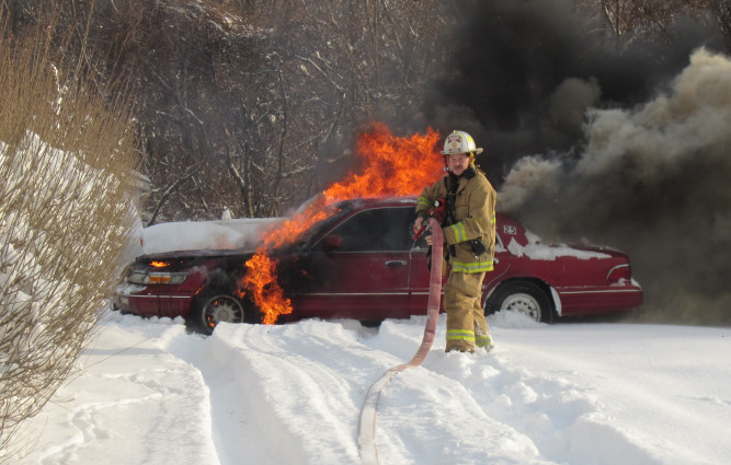 A red sedan was destroyed by fire Wednesday on Northern Avenue in Augusta.