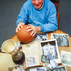 Ted Shiro poses with some sports mementos from his long basketball and baseball career on Sept. 28, 1998. Shiro died Wednesday. He was 87.