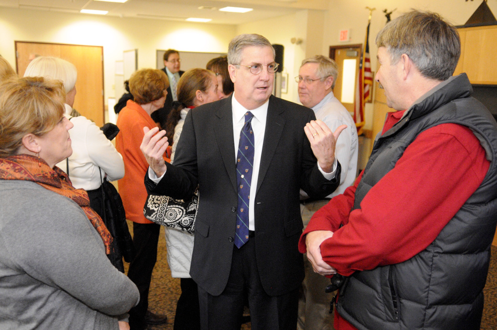 James Conneely, the new president at the University of Maine at Augusta, speaks with people attending the announcement of his appointment in December at the UMA campus.