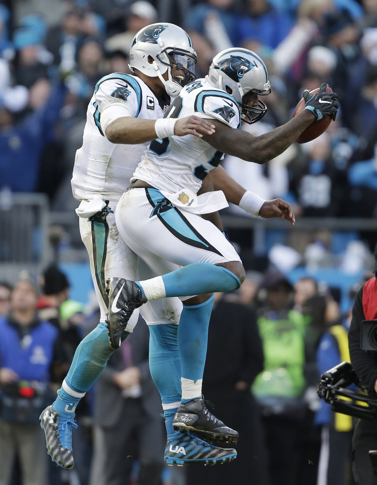 Carolina Panthers quarterback Cam Newton (1) celebrates with Carolina Panthers outside linebacker Thomas Davis (58) after Davis caught the onside kick made by Seattle Seahawks during the second half of an NFL divisional playoff football game, Sunday, Jan. 17, 2016, in Charlotte, N.C. The Panthers won 31-24. (AP Photo/Bob Leverone)
