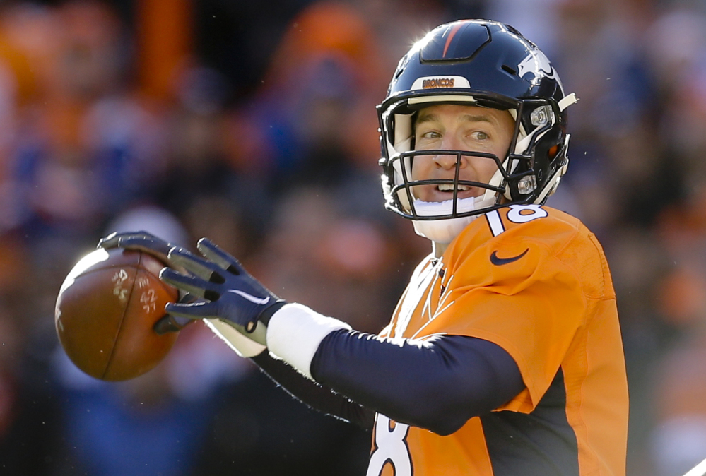 Denver Broncos quarterback Peyton Manning passes against the Pittsburgh Steelers during the first half in an AFC divisional playoff game Sunday in Denver.