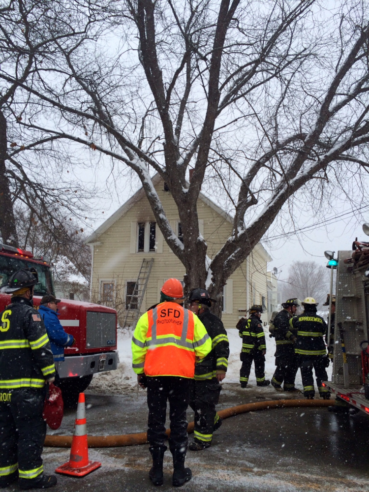 Firefighters battle a blaze at 88 Old Point Ave. in Madison on Monday afternoon.