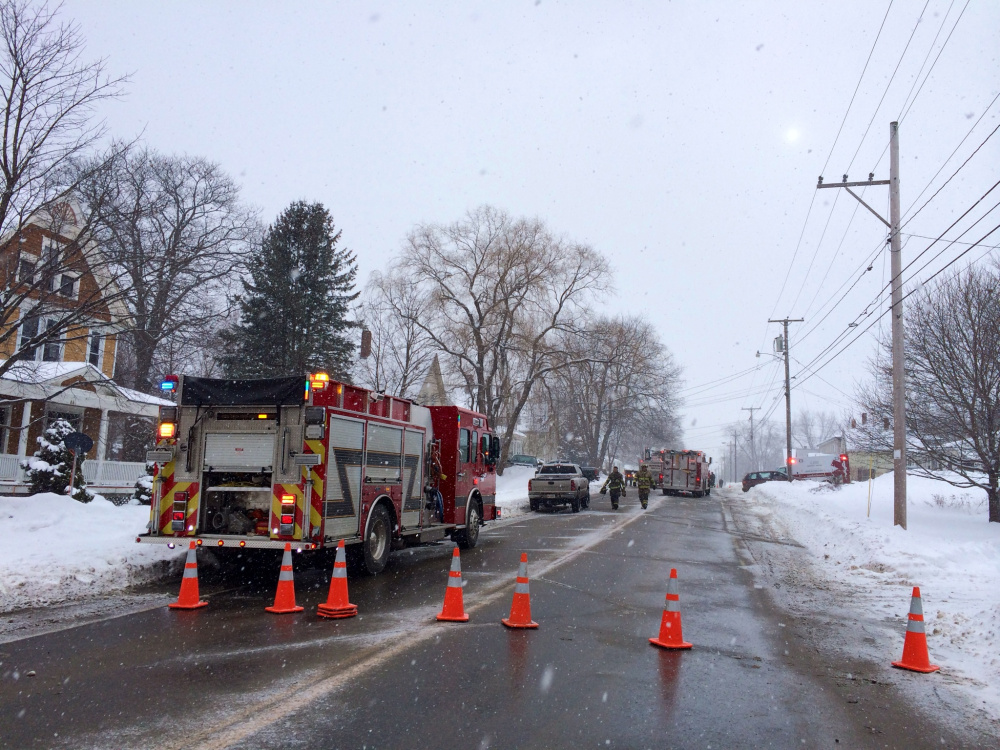 Old Point Avenue, which is also U.S. Route 201A and one of the main streets through Madison, was blocked Monday afternoon as firefighters responded to a house fire.