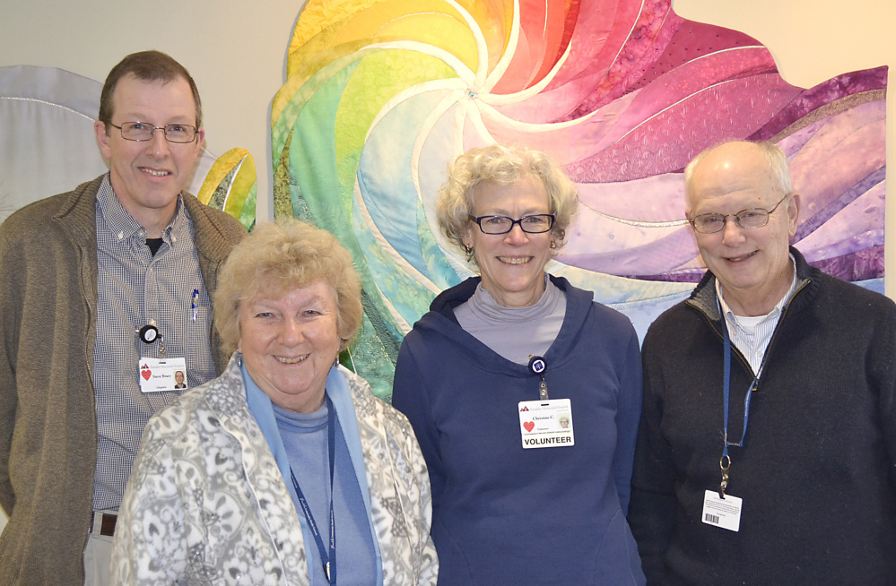 Contributed photo From left are the Rev. Steve Bracy, Sally Smith, Christine Cox and the Rev. Tim Walmer.