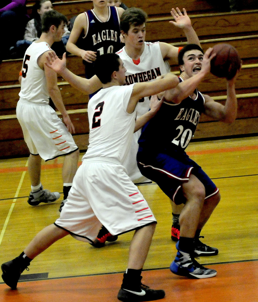 Messalonskee's Jack Bernatchez looks for a shot as Skowhegan's Christopher Marcus (2) defends during a Kennebec Valley Athletic Conference Class A game Monday afternoon.