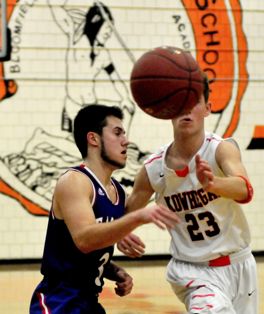Skowhegan's Brendan Curran looks to haul in a pass as Messalonskee's Sawyer Michaud defends during a Kennebec Valley Athletic Conference Class A game Monday afternoon.