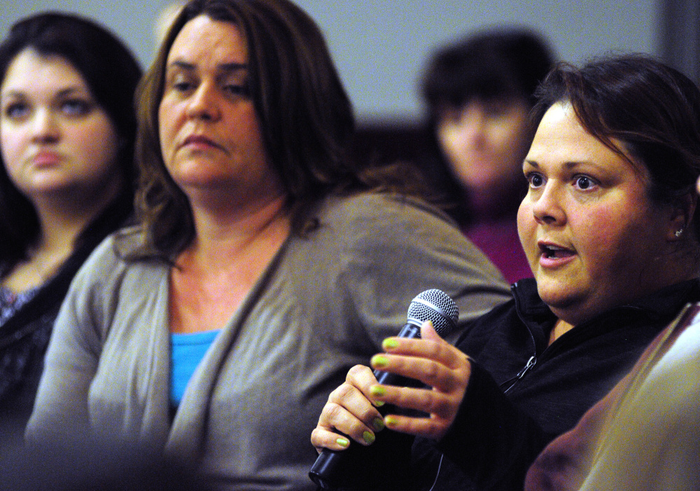 Jodi French, right, who works as an acuity specialist at Riverview Psychiatric Center, speaks on Tuesday during a meeting between Riverview workers and some state legislators at the University of Maine at Augusta.
