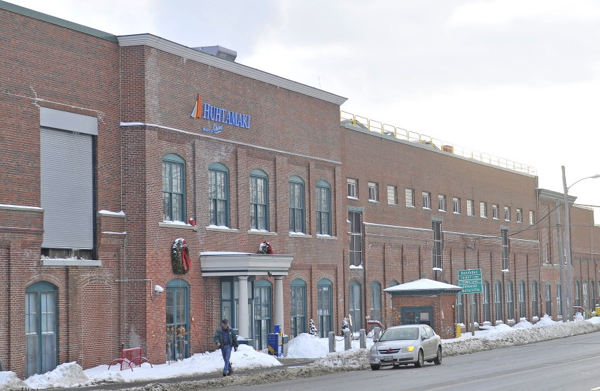 The Huhtamaki manufacturing plant on College Avenue in Waterville will temporarily lay off 25-30 workers as the company deals with a slowdown in demand for its packaging used by the Chipotle restaurant chain.