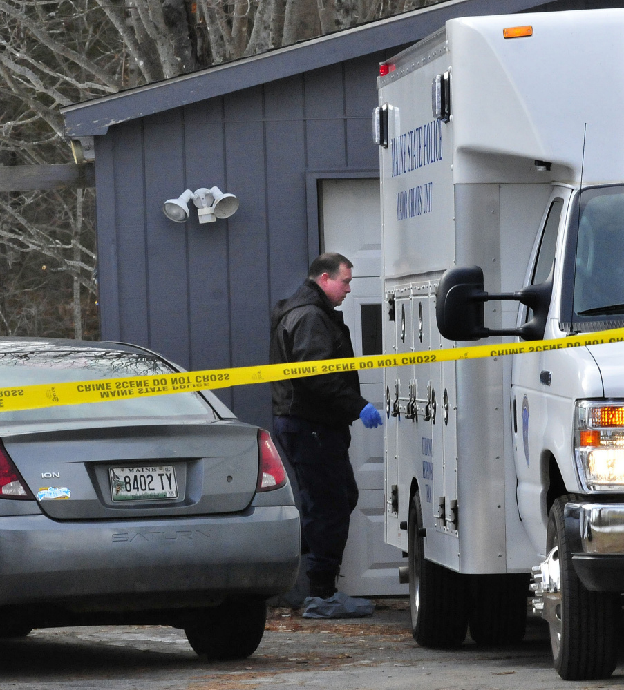A state police investigator enters the rear of the Major Crimes Unit while conducting an investigation at 457 Norridgewock Road in Fairfield on Jan. 12.
