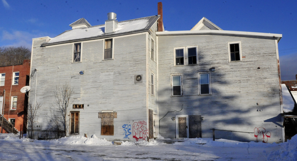 The rear side of the vacant and dilapidated Antlers Inn building in Bingham on Wednesday. Vacant for eight years, the building may be torn down by the town.
